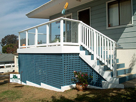 Timbertech deck with tempered glass rails and lattice
